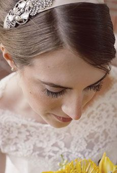The bride accessorized with a headband by Jennifer Behr. Photo by Carla Ten Eyck Photography
