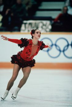 E, Germany's Katarina Witt steals olympic gold from U.S. favorites Elaine Zayak and Rosalyn Sumners.  A big upset.