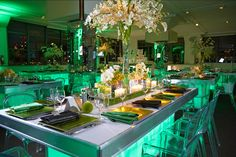 Table decor featuring Pantone's color of the year, Emerald. Bar Mitzvah by Diana Gould Ltd.  Michael Jurick Photography.