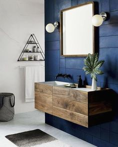 Dark colours for elegant bathrooms… Dark colours can add glamour and elegance to any bathroom. Use a navy blue shade as an accent colour for a bold and sophisticated appearance. Combine with modern wood furniture and black tapware to finish off this stylish look.  . #wholesaledomestic #darkinteriors #luxurybathrooms #bathrooms #bathroomdecor #bathroomdecorating #bathroomdecor2019 #bathroomdesign #bathroomidea #bathroominspiration #dreambathrooms #bathroominterior