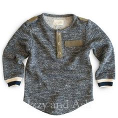 Miki Miette Fall 2016 collection features their Miki Miette Boys Major Tweed Henley. This adorable crewneck top is a tweed long sleeve top decorated by stripe cuffs, a faux pocket, and a 3-snap front