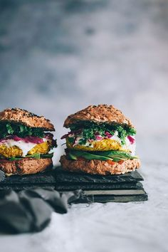 Spiced cauliflower burger with sauerkraut, avocado and kale | http://TheAwesomeGreen.com