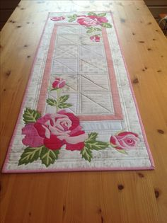 Summer Roses Adorn this Beautiful Table Runner.