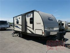 This 2015 Coachmen double slide Freedom Express 233RBS travel trailer by Coachmen RV has all the room you need and more!