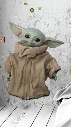 """Pre-order """"The Mandalorian: The Child Peel and Stick Giant Wall Decals"""" and add this Giant Baby Yoda decal to Star Wars room decor. Hollween Costumes, Star Wars Costumes, Star Wars Classroom, Classroom Themes, Roommate Decor, Roommates, Baby Yoda Costume, Star Wars Room Decor, Yoda Images"""