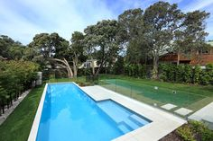 glass wall and iron fence close off pool for safety but easy visiblity  auckland - jessop architects