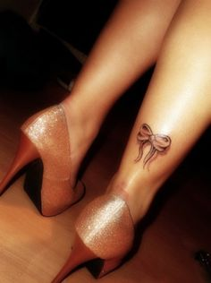 Cute placement for the bow tattoo idea that Sis and I are getting, for being 'tied together'