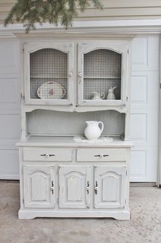 @Ashley Sharp - if you took the glass out of your hutch, you could replace it with chicken wire! Cute.