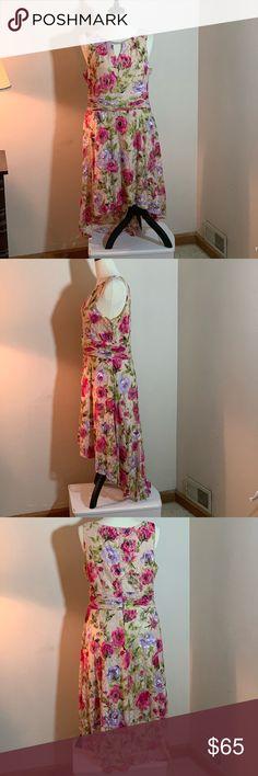 5e490fb6dfe2b Ladies sleeveless dress Sleeveless floral lightweight dress. Keyhole front  w metal embellishment. Dress is