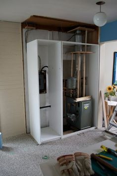 Cabinet to hide the boiler and fuse box - Home Decoration Views