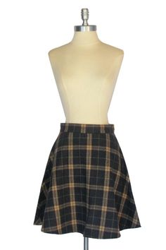 *This Item Is Final Sale* We've never met a plaid we didn't love, and this neutral-hued tartan skirt is no exception. Thanks to its grey and camel pattern, a classic tone is achieved whenever the piec
