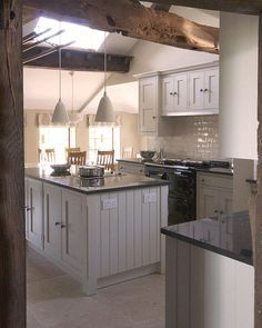 A bespoke hand painted kitchen, designed and installed by Cheshire Furniture Company.