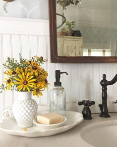 Love the beadboard and black faucet.