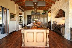 Rustic Spanish Inspired Kitchen Center Island Highlights by Zbranek  Holt Custom Homes, Austin and Horseshoe Bay Luxury Custom Home Builder