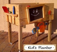 Kid's Mobile Veg & Fruit Planter with play gardening tools and watering can so the children can have fun and learn to take care of their garden