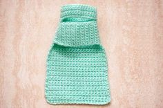 How to Crochet Easy Dog Sweaters. Keep your doggie warm on wintry walks with some crocheted dog sweaters. This sweater pattern is basically a large rectangle with a belly flap and a neck loop. The project requires basic knowledge of crochet and uses just the chain and single crochet stitch. This sweater is for a small dog, but the pattern can be...