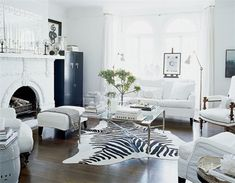 On The Cheap…A Hunt for a Zebra Rug Williams Sonoma zebra rug. Via Elle Decor. This room is white and neutral and the zebra rug adds a real punch White Interior, Interior Design Living Room, Modern Shabby Chic, Home And Living, Black And White Living Room, White Rooms, House Interior, White Decor, White Living Room Decor