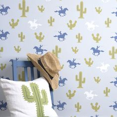 Cactus Cowboy Wallpaper from Hibou. A children's wallpaper featuring silhouettes of cowboys on horseback galloping through a cacti landscape in grey, blue and green. Cowboy Bedroom, Cowboy Nursery, Nursery Boy, Nursery Decor, Cool Kids Rooms, Kid Rooms, Boys Wallpaper, Print Wallpaper, Wallpaper Designs