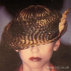 1979 plait creative hairstyle    A prepared basket weaved hat was placed on top of short brunette hair    Hairstyle by: Noel Serra