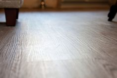 The vinyl plank floors are made by Vesdura High Performance 5mm in the Century Oak finish. from Build Direct