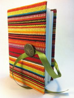 Handmade Journal / Notebook made with colorful stripes fabric opens with vintage brass button and green satin ribbon by  http://www.etsy.com/shop/Newleafjournals?ref=si_shop