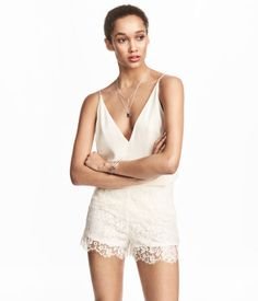 Natural white. Loose-fit camisole top in woven crêped fabric with a V-neck. Narrow shoulder straps crossed at back.
