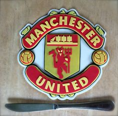"""For all those hugh Manchester United fans, here is the topper for you!!! Place this ontop of the next cake for your friend or loved one and they will go crazy, just like they were watching a game :)  Size: 7"""" wide and about 8"""" tall"""