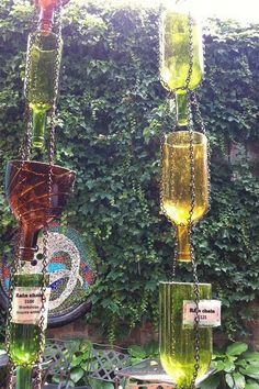 Up Cycled Wine Bottle Rain Chain. Not only make a good sound and enhance your house exterior appearance, but also divert water away from your house. http://hative.com/creative-rain-chains/