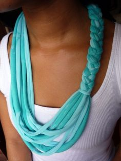 T shirt scarf--After cutting up an old, stretchy t-shirt into thin strips, I braided half the strips and set half aside. I then connected the two parts by wrapping another piece of t-shirt around the top and bottom of the braid.  This took about an hour in front of the telly