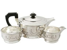 Sterling Silver Three Piece Tea Service - Art Deco Style - Antique George VI  SKU: A3968 Price  GBP £1,795.00  http://www.acsilver.co.uk/shop/pc/Sterling-Silver-Three-Piece-Tea-Service-Art-Deco-Style-Antique-George-VI-67p7944.htm#.Vk3HbL88rfc