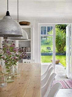 Swedish Cottage | photo jonas lundberg. Simple, rustic dining room with French doors leading to a lovely garden. So perfect