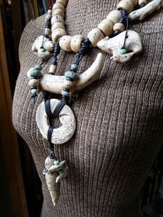 """Handmade polymer clay necklace by Luann Udell, """"Shaman Necklace--Sea Lion Woman""""."""