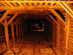 Railroad tracks.  Wooden timbers used as roof support in this coal mine.