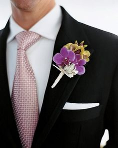 purple and green boutonniere