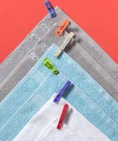 Clothespins as Bath Towel Labels - either use colored clothespins for each person, or use wooden ones and write people's names on them.