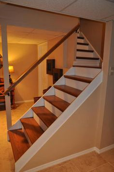 Featured Simple Staircase Remodel With Wooden Steps And White Accent Plus Wood Log Holder Combined With Yellow Lights Near It Homeyapt & How to Build Simple Stairs | Pinterest | Basement stair Basements ...
