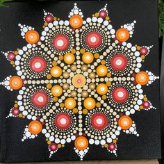 Hand painted dot mandala on a stretched canvas. Painted with acrylic paints. Black background with golds, yellows, reds, orange, cream and white dots. Mandala Canvas, Mandala Artwork, Mandala Painting, Dot Art Painting, Painting Patterns, Stone Painting, Mandala Pattern, Mandala Design, Mandela Art