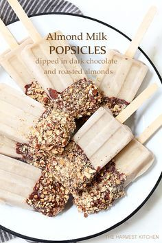 You can eat all of these Healthy Almond Milk Popsicles you want this summer!  They're made with almond milk and bananas and they're dipped in heart healthy dark chocolate and roasted almonds.