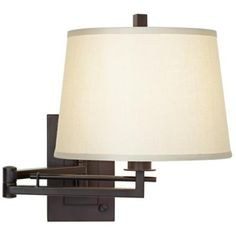 Matte Bronze Plug-In Swing Arm Wall Light  Style # R4625 - MOST POPULAR! Read 15 Reviews  Write a Review With a fabric drum shade and full range dimmer switch to create soft lighting, this matte bronze finish swing arm wall light extends 24 inches from the wall for lighting ease.  $119.99 + FREE SHIPPING & FREE RETURNS*  Compare $179.99   Lampsplus.com