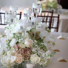 Here is a pic of 6 different floating candle holders with a floral centerpiece