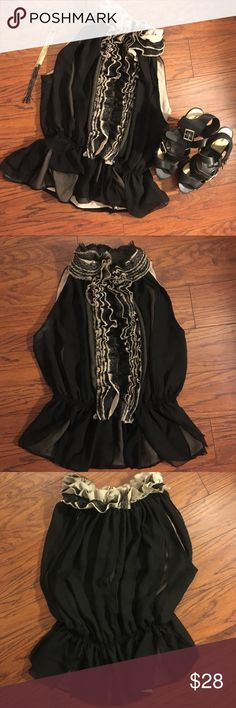 Target by Neiman Marcus Black/Beige Ruffle Top Very cute sleeveless top that's perfect for daytime brunch, a night out, or work! This top is by Neiman Marcus designer Robert Rodriguez and from the Target by Neiman Marcus line. It has black and beige lace overlays for a fun accent and layerings of black and beige chiffon. Two-button closure at the neck. Pair it with glamorous earrings and your favorite heels for a classy look! In great condition. **Reasonable offers welcome, no trades…