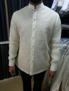Modern Filipino Barong made of piña cocoon. Tailored by Jose Mari Haberdashery. Shop is located at Kamuning Market, Quezon City, Philippines Tailor is Joemar Habana. Orange Wedding Guest Dresses, Wedding Outfits For Groom, Wedding Dresses With Flowers, Wedding Attire, Barong Tagalog Wedding, Barong Wedding, Wedding Tux, Wedding Gowns, Modern Filipiniana Gown