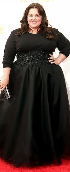 Comedy queen Melissa McCarthy wore a black top with a custom Marchesa skirt at the 2014 Emmys.