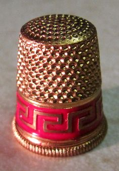 RP:  VINTAGE AUSTRIAN THIMBLE - GOLD-TONED WITH A RED BAND AND GOLD DESIGN - ebay.com