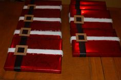 Gift wrapped like Santa Suit...cute way to wrap presents so the bow doesn't get smashed- would be great as gifts from Santa under the tree.