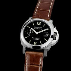 Panerai Luminor Marina: This Panerai Luminor Marina is round. When we say round, we really mean round. Which isn't a bad thing, but it is definitely the first thing that stands out about this watch, with the second thing being it's small size, compared to other Panerai watches at only 40mm for the case. It features a brown leather strap as well that compliments the watch nicely.