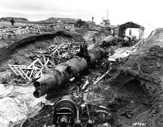 Three Japanese Type A-class midget submarines wrecked by demolition charges at a former Japanese base on Kiska Island Aleutian Islands 7 September 1943.