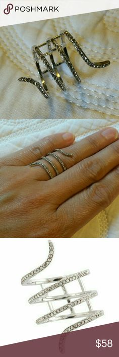 Snake ring in Silver size 6 Quadruple wrap around style  Reinforced with three crossbars in back to maintain shape  Pave studded finish  Rhodium plated with pave crystals  NWOT  Never worn except to model Ella Jewelry Rings