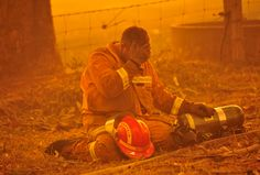 Exhausted Firefighter on Black Saturday at Bunyip State Park in Victoria, Australia Firefighter Paramedic, Firefighter Quotes, Volunteer Firefighter, Fire Dept, Fire Department, Black Saturday, Emergency Responder, Chicago Fire, Chicago Pd