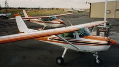 1980 Cessna 152 N4649L and 1975 Cessna N9038H parked at the old Rio Vista Airport O88 in California.